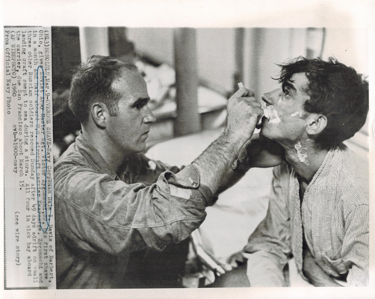 OVERDUE SHAVE-Navy Corpsman Dale I. Davis of Barbert, Ohio, gives Soviet Army Master Sgt. Victor Zygonschi,22, his first shave in a month and a half aboard U.S. aircraft carrier Kearsarge.