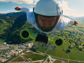 Austrian Peter Salzmann piloting his electric wingsuit. The electric portion, with ducted fans, is stapped to his chest.