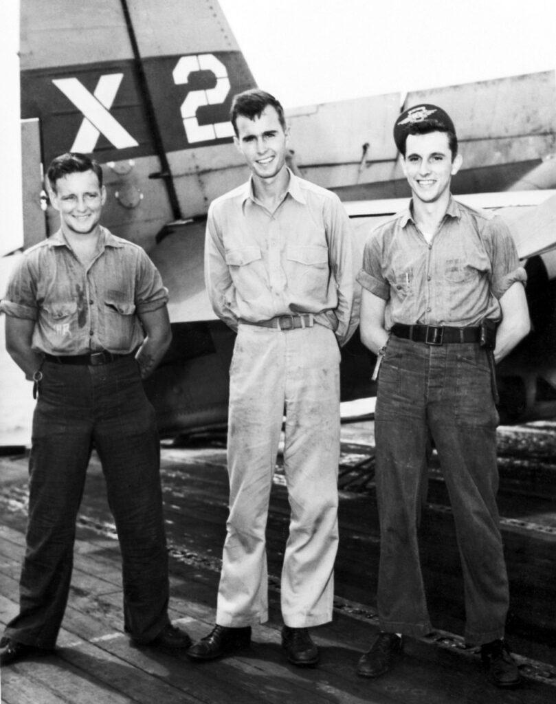 Lieutenant (j.g.) George H. W. Bush (center) with X-2 flight crew: radioman Joe Reichert (left) and turret gunner Leo W. Nadeau (right), November 2, 1944.