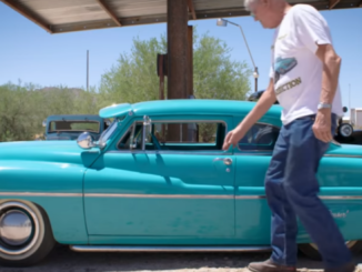 Ernie Adams about to get into the tiny replica of a 1949 Mercury that he built by hand.